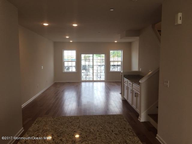 open layout with hardwood flooring