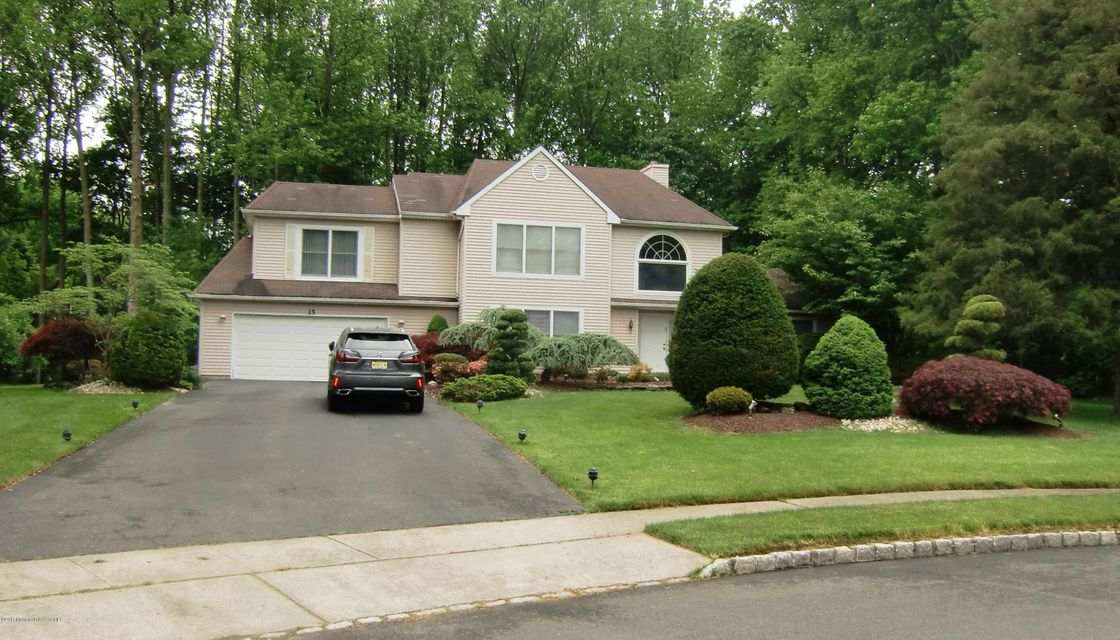 Photo of home for sale at 15 Winding Woods Way Way, Manalapan NJ