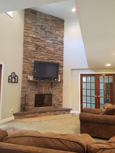 2 STORY STONE FIREPLACE IN FAMILY ROOM