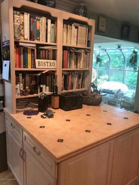 island with cookbook shelf