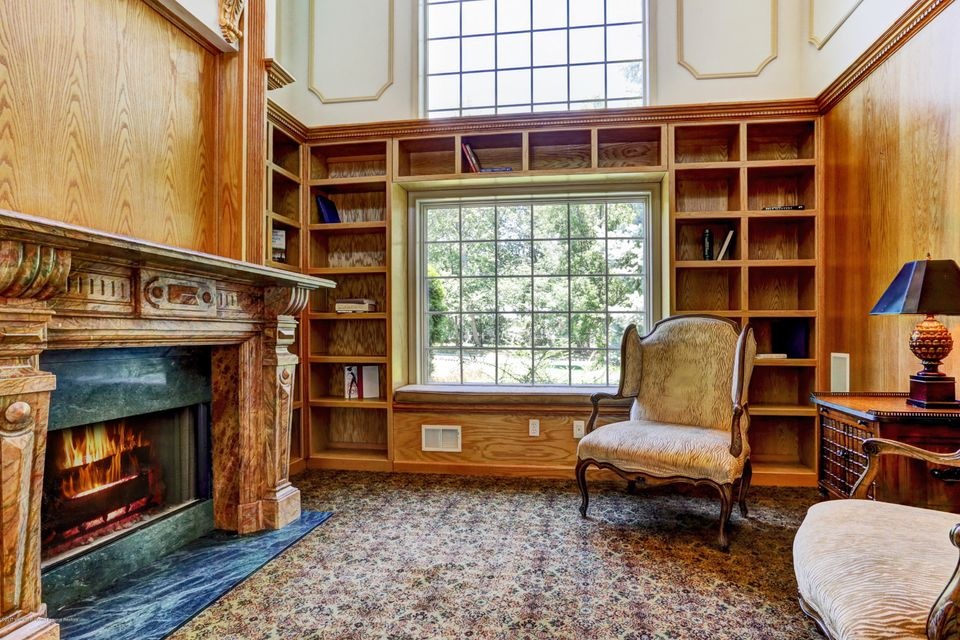 Two Story Library With Fireplace