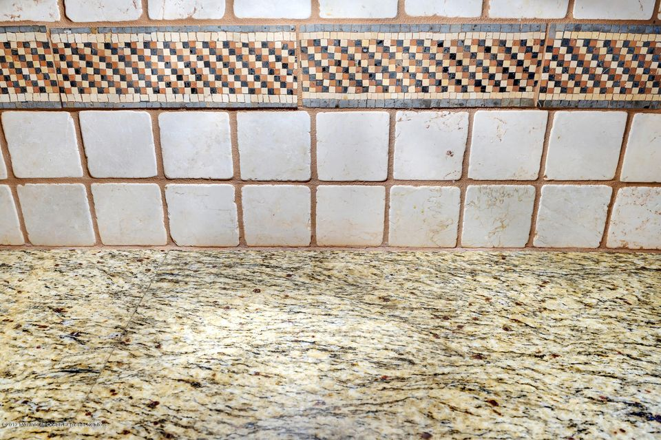 Italian tumbled marble backsplash