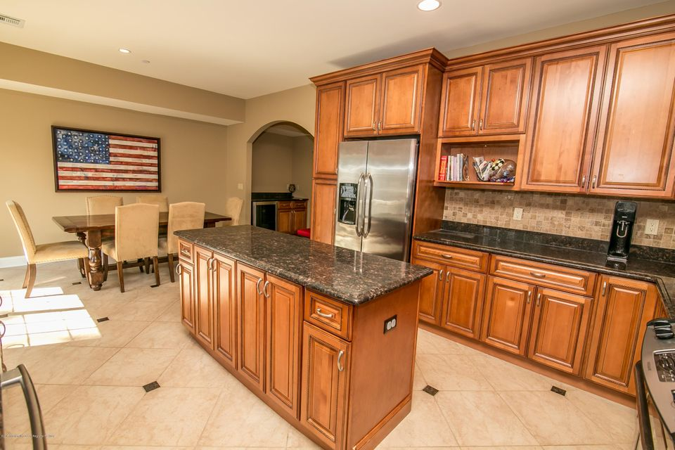 Huge Kitchen with slicers to deck