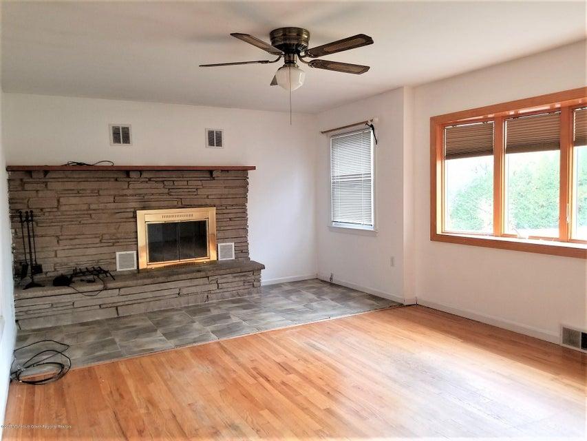 LIVING ROOM W/FIREPLACE & BOW WINDOW