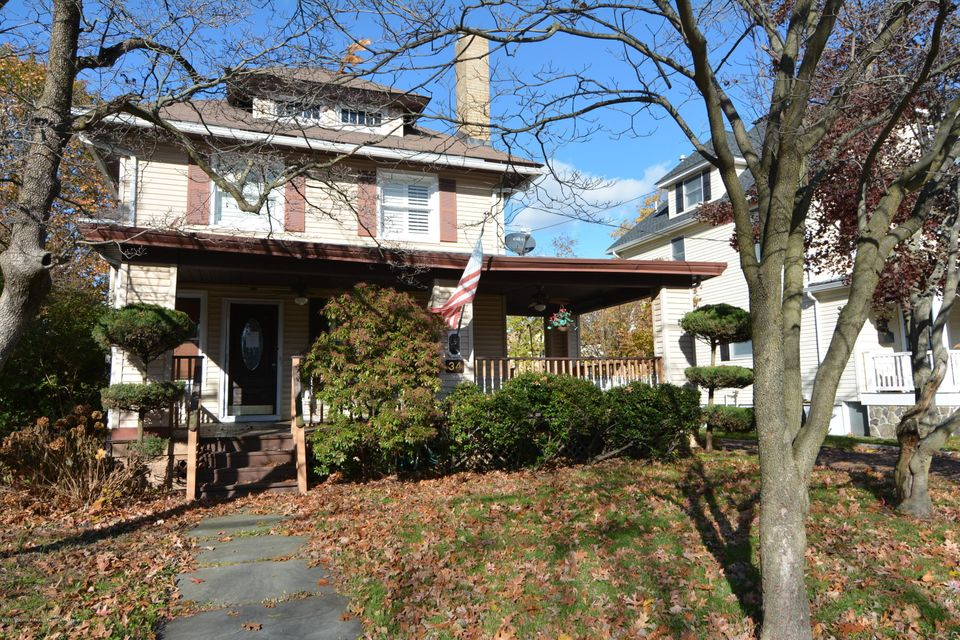 Classic colonial with rocking char porch