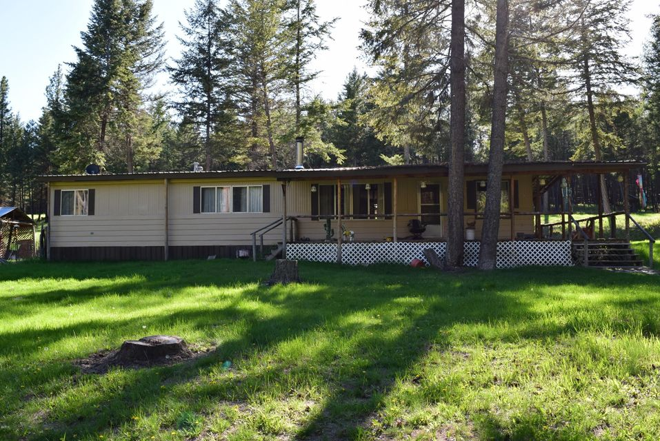 Enjoy Montana in the beautiful West Kootenai area, Think investment with 3 bed, 2 bath home situated on 2, 1 acre lots, across the street from National Forest land, a short drive to lake Koocanusa and lots of  recreation.  The front yard has 2 of the best pie cherry trees round, there is a woodshed, carport, underground root cellar and more to appreciate about this property, enjoy the peace and quiet of the beautifully treed area of Pine Valley Acres !