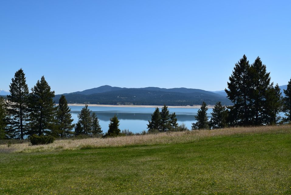 Lake Koocanusa is just a short walk from this property. Direct access to the lake across Forest Service land! Gorgeous lake and Mountain views. There are 3 lots total. A great opportunity to own 3 great lots totalling almost 2 acres very close to the Lake ! Keep the grass green and the garden growing with irrigation water from Dodge Creek.  Home on the property is currently inhabited but is given no value but certainly could be lived in while building a new home. Think investment opportunity with Lake Koocanusa becoming more and more popular and land on the west side of the lake becoming harder and harder to find.