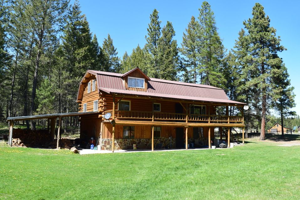 3 bed, 3 bath Log Home with a large rec/tv. room, plus office area in the basement,9.34 Acres and 11,422 square ft of outbuildings , This property has  3 very large garage/shop type outbuildings with concrete floors, 47x50,80x60,56'x52,perfect for the car collector, or woodworker! One of the buildings has a guest apartment, property borders Forest Service and is just a short walk to Lake Koocanusa
