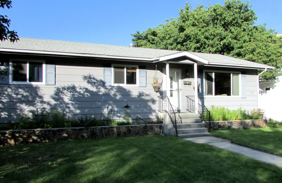 Few areas in Missoula feel as special as the Beautiful Lower Rattlesnake! Close to Greenough Park, The University of Montana & Downtown. Outside this large Double Lot has a comfortable backyard Patio with Landscaping & shade. The double detached Garage is finished on the inside, includes a Pellet Stove to keep you toasty in the winter. The home has had some major updates recently with a new Furnace, new Dishwasher, new Front Door & new Windows throughout. Open floor plan with a Sunny kitchen & living room. Main floor bathroom updated with a new tub, vanity & fixtures. The basement has 2 bonus rooms that could use egress windows to make into legal bedrooms. It has a large family room & ample storage. Tons of sq. ft. for this area. Perfect Location in a great Neighborhood!