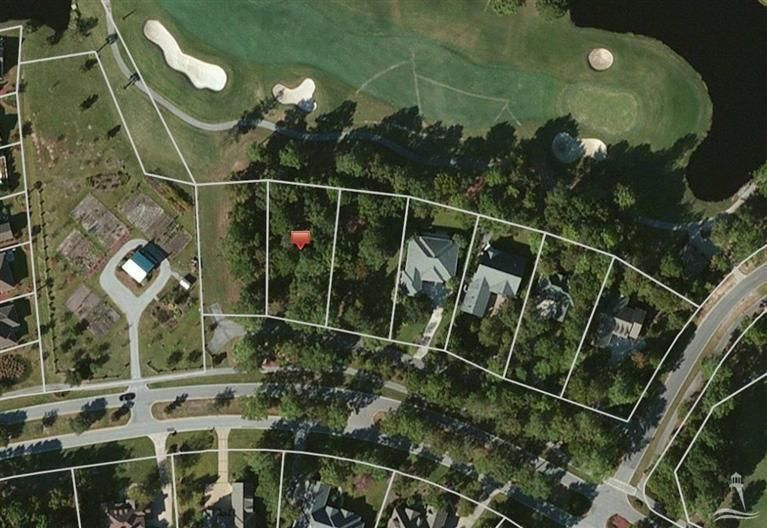Secluded, cul-de-sac building lot with panoramic views of highly regarded Lion's Paw golf course in prestigious Ocean Ridge Plantation. This partially wooded homesite offers its future owner a gorgeous long fairway view down the fairway of hole 14 and pond across fairway. Priced competitively this golf front building lot won't last long. Building lots to left and right are also available by seller.