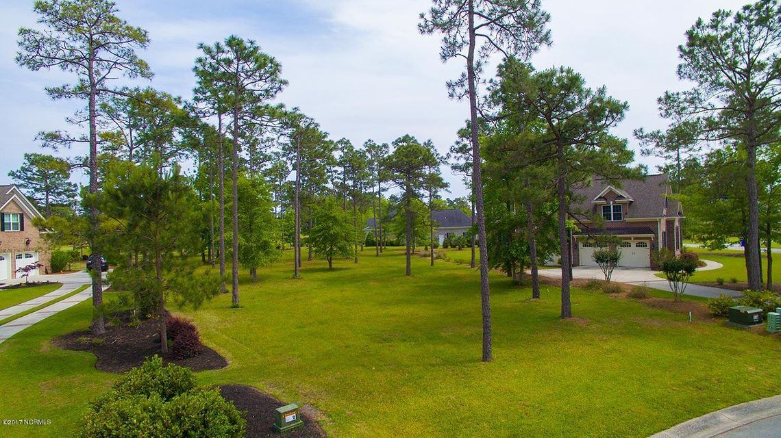 Dream home...meet dream lot. More than 7/10 acre building lot with panoramic golf views of hole 14 and 15 on the award winning Panther's Run golf course in prestigious Ocean Ridge Plantation. This property offers the flexibility for that dream home and the eastern exposure will treat you to morning sunrises and afternoon siestas, relaxing on your future deck or patio. Located in the desirable Dartmoor Woods neighborhood, you minimum home is just 2,000 heated sq/ft. Ocean Ridge Plantation is southeastern North Carolina top beach and golf community. Ocean Ridge residents enjoy four 18-hole golf course, ocean front beach club on Sunset Beach, indoor/outdoor pools, fitness, miles of walking trails and much more.