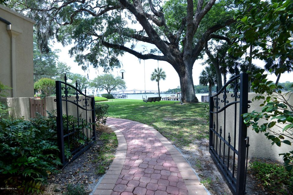 Gate to rear yard and riverfront.