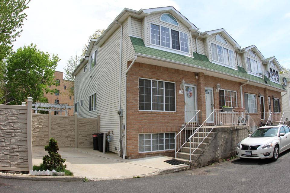 Single Family Home for Sale at 105 Woodcutters Lane Staten Island, New York 10306 United States