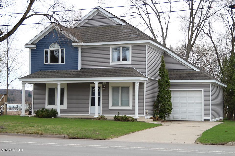 Single Family Home for Sale at 5065 Main Street 5065 Main Street Onekama, Michigan 49675 United States