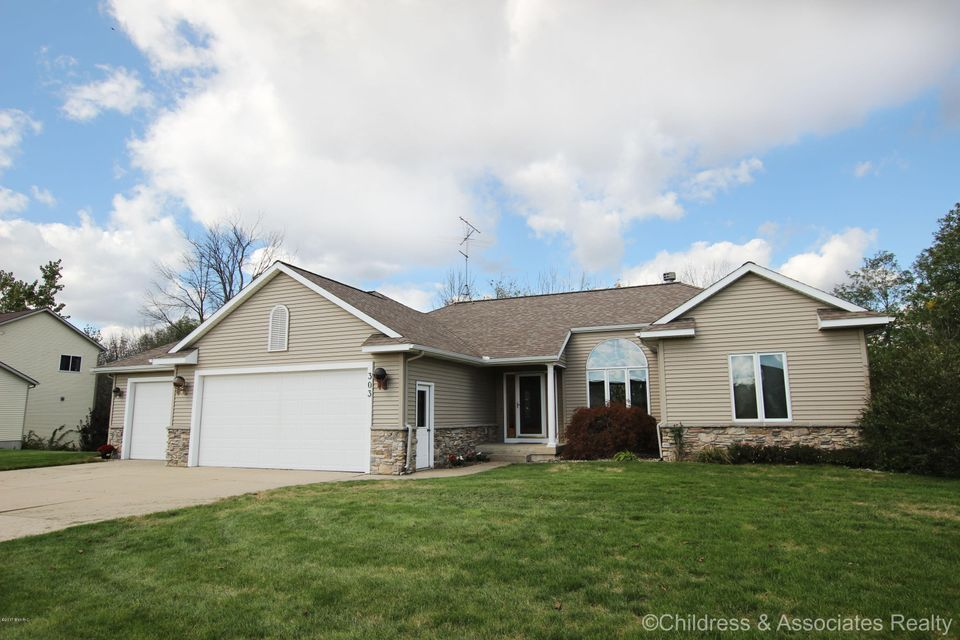Single Family Home for Sale at 303 Creekside 303 Creekside Coopersville, Michigan 49404 United States
