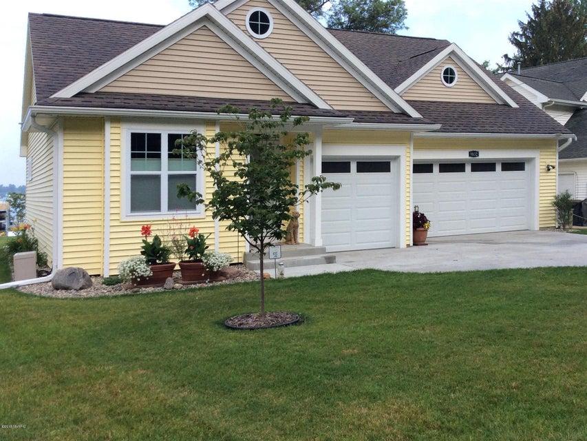 Photo of home for sale at 9832 E Shore Drive, Portage MI