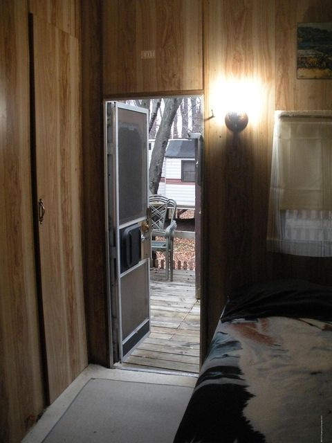 Single Bedroom with Door to Side Deck