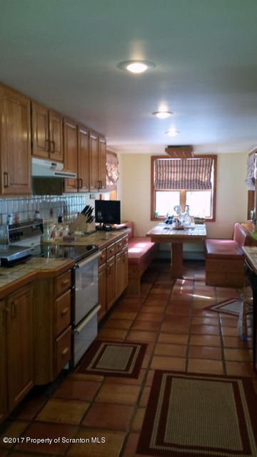 kitchen view with built in eating area
