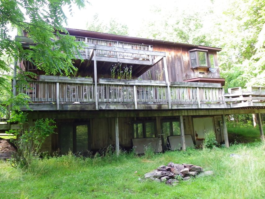Clearly a nice secluded property but within a few minutes from town. This house features a  contemporary style -lots of space and good size rooms. Master suite with balcony. Oversize storage room . great family room .  Do your work from home in the over size office.  Must see to appreciate.