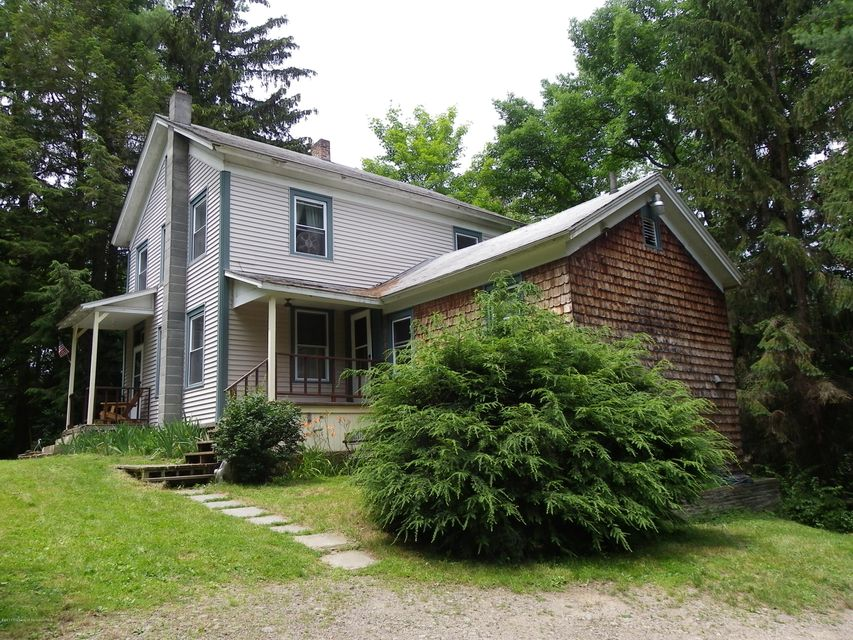 In town but all by yourself on a nice isolated lot with over an acre. This3 bedroom home has the potentionalof many optionals.  Very spacious. Park like setting with some nice gardens. All gas right convey.