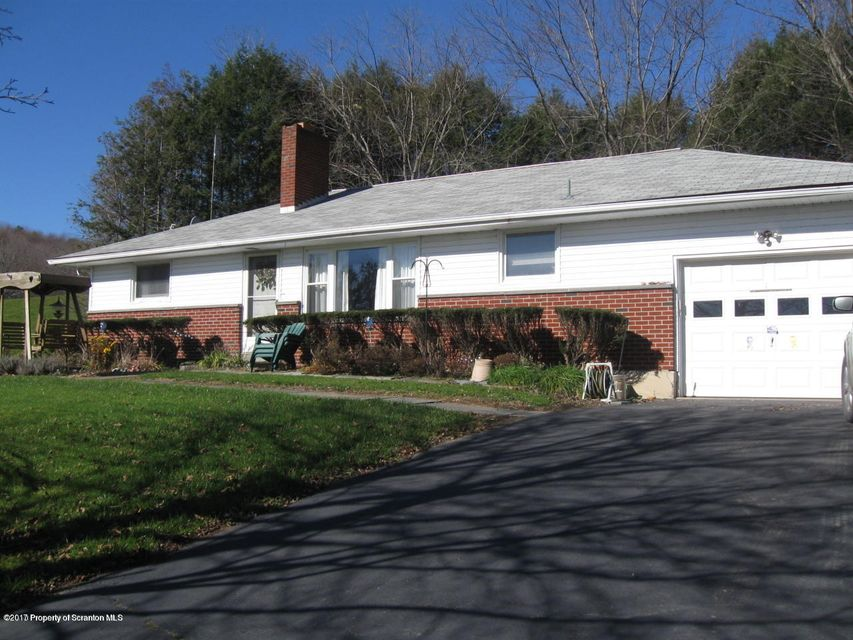 This home has an all season room with electric fireplace, sandstone floor around living room wood fireplace. Garage with workshop and cold pantry off kitchen. Please call for appt.