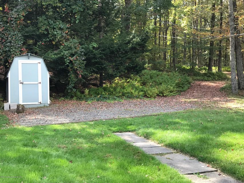 Parking area & shed