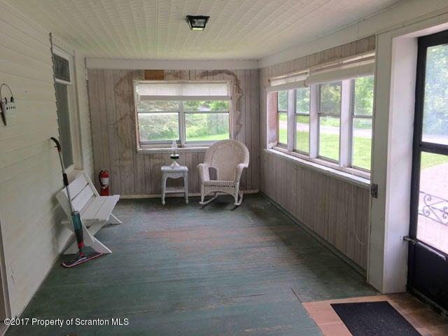 Enclosed Sunroom (Unheated)