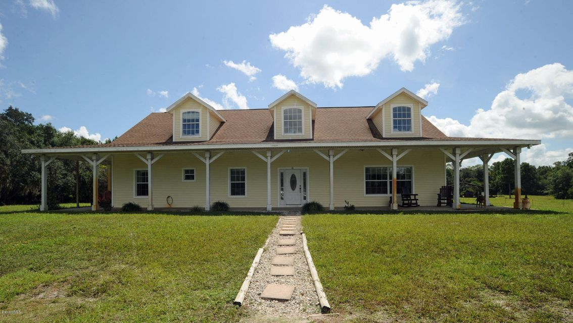 Maison unifamiliale pour l Vente à 415 Stacy Grove Oak Hill, Florida 32759 États-Unis