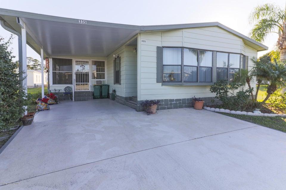 獨棟家庭住宅 為 出售 在 335 Macadamia 335 Macadamia Barefoot Bay, 佛羅里達州 32976 美國