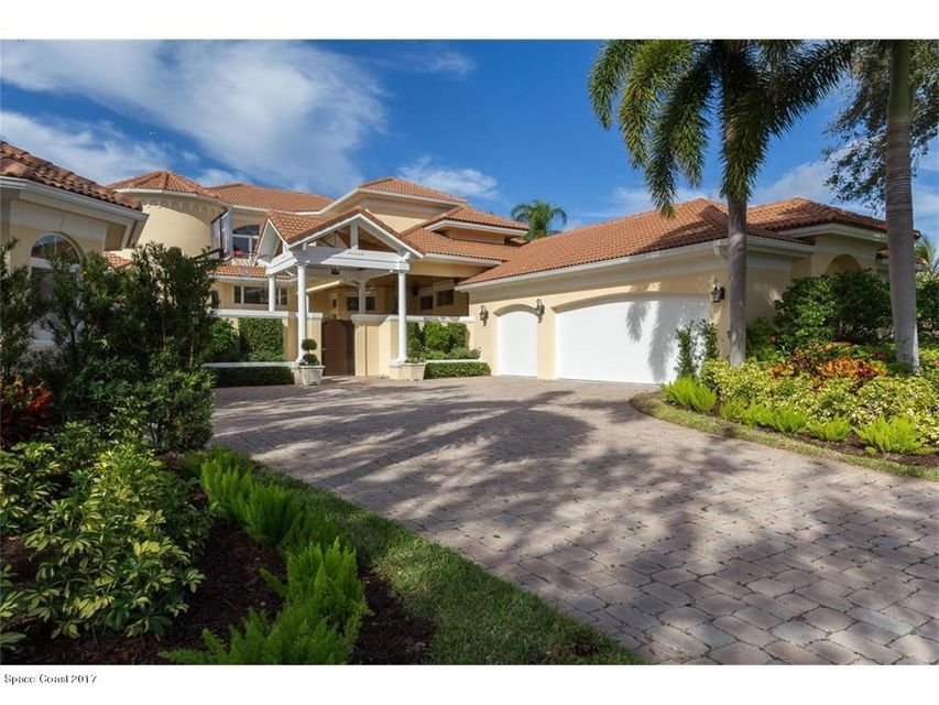 Upscale 4/4/4 +3 car garage. Resort style pool complements covered patio for fun filled hours in the warm Fl. weather. Beautiful estuary, golf and lake views. Rich with detailed features and recently redecorated. Cabana with bath Almost 4,000 sq. ft. Courtyard home. Membership with incentives. This is a massive reduction. Sellers are ready to move on. Sizes approx./ subj. to error.