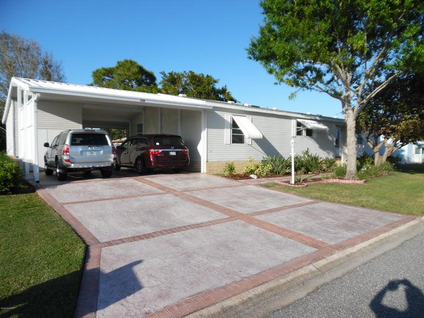 Maison unifamiliale pour l Vente à 328 Loquat Barefoot Bay, Florida 32976 États-Unis