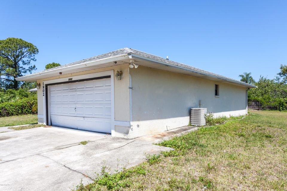 Calling all investors and those who don't mind some sweat equity. This three bedrooms and two bathroom home is located on a corner lot, approximately 2 miles from Bayside lakes shopping area. This property is being sold AS IS without warranties or repairs. Come and make an offer today.