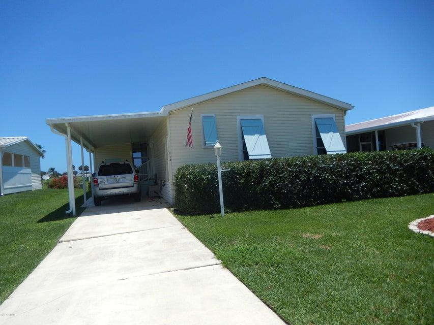 Maison unifamiliale pour l Vente à 1112 Barefoot 1112 Barefoot Barefoot Bay, Florida 32976 États-Unis