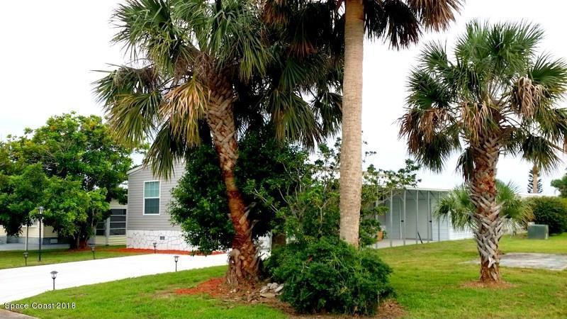 Maison unifamiliale pour l Vente à 909 Hawthorn 909 Hawthorn Barefoot Bay, Florida 32976 États-Unis