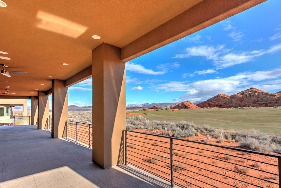 THIS FINISHED CUSTOM HOME WITH THREE MASTER SUITES, FANTASTIC VIEWS OF ZIONS ON 2ND HOLE OF GOLF COURSE. CONTEMPORARY DESIGNER TOUCHES COMPLETE THE ACCTRACTIVELY FINISHED LIVING/ENTERTAINING AREAS. 3 MASTER SUITES, A WELL APPOINTED CUSTOM FURNISHINGS PACKAGE WHICH COMPLETES THIS SPACIOUS HOME IS AVAILABLE.2 WELL EQUIPPED WET BARS, 2 LARGE FAMILY ROOMS,4 LARGE SCREEN TVS, LARGE BUNK ROOM SLEEPS 10