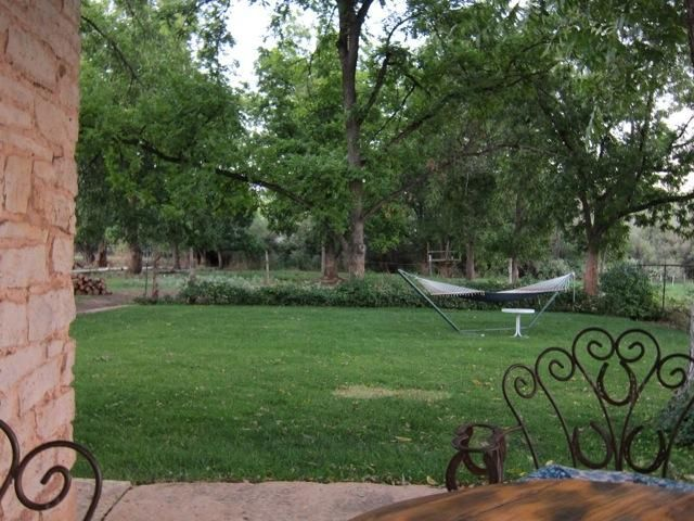 FEATURED IN COUNTRY LIVING MAGAZINE!! ZION GETAWAY BY THE RIVER! Historic two-story stone farmhouse at the end of a shady lane on 3.25 acres by the Virgin river. Tastefully restored 1880\