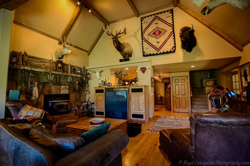 Spectacular ranch style home. Perfect family retreat. Many options for this property:potential bed and breakfast,vacation rental, primary or shared residence, corporate retreat, or Air Bnb. 7220 feet and 4 car garage with tack room. Highest quality construction. 16 Ft vaulted ceilings with exposed beams in Great Room and 10 ft ceiling with exposed beams in Master.Large open spaces including three
