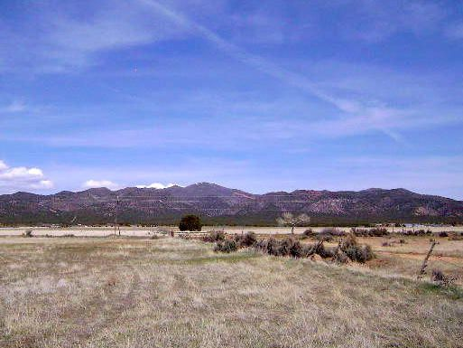 Amazing Views!!! Large 8.2 acre parcel located directly north of the New Harmony Cemetery.  Zoned R5 (5 Acre Residential up to two large animals).  Gas on main road, water at cemetery, power would come from 175 East (next street over).  Rocky Mountain Power. There are no CC & R\