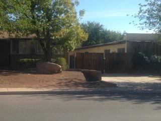 Unique & recently upgraded- new carpet, paint, cabinetry! Large shop with power, perfect for workshop or home office. Also includes bombshelter. 2 large driveways on both sides of home. Property includes 2/3 share water with Warm Springs East Ditch. Located near new policestation and fire station. Currently rented through February 2018.