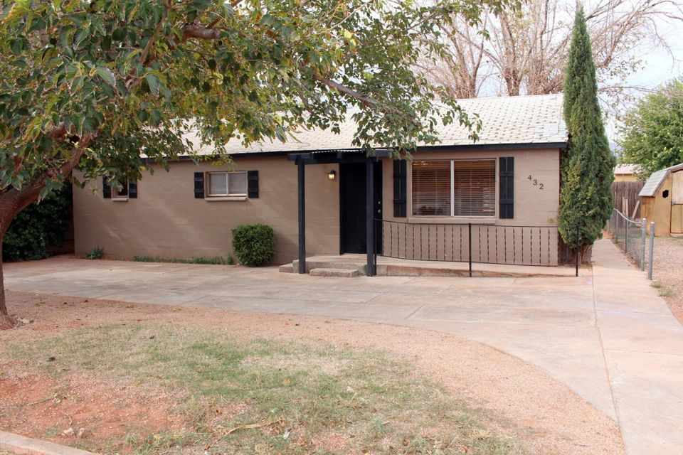 Charming home located on .22 acre. HUGE yard with 4 driveways. Storage sheds. Red Mountain Views! Possible commercial property. Huge potential.