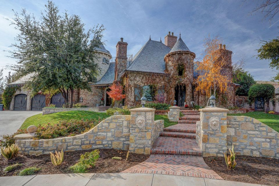 This stunning French Country Home sits on over an acre in the lush river bottoms of charming Santa Clara, Utah. Dozens of trees and terraced landscaping surround this 8,500 square foot masterpiece of old world architecture and modern conveniences. From the copper finials, gutters, and cupola to the chimney pots (salvaged from England), this dramatic home was built with meticulous detail and wired