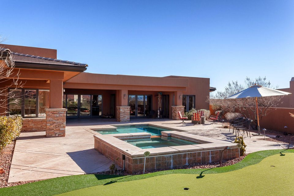 The home was designed and built with style and quality in mind. Single level living and a well thought-out floor plan provides numerous places to relax and enjoy the incredible views of the 13th. fairway and red mtns. Practice on your personal putting green or enjoy Snow Canyon while soaking in your private swimming pool and spa.