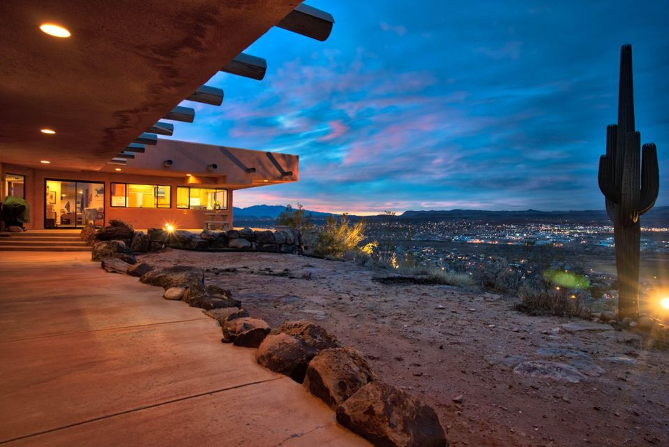 LIVE ON THE EDGE AND ENJOY 360 DEGREE VIEWS IN THE HEART OF WASHINGTON FIELDS. The private gateway, at the bottom of the mountain, leads up to the mountain crest, where the estate sits in complete solitude. This property includes other square feet, namely a 1,500 sf detached building and a 3,228 sf metal building with high ceilings. The metal building has a bathroom and an office