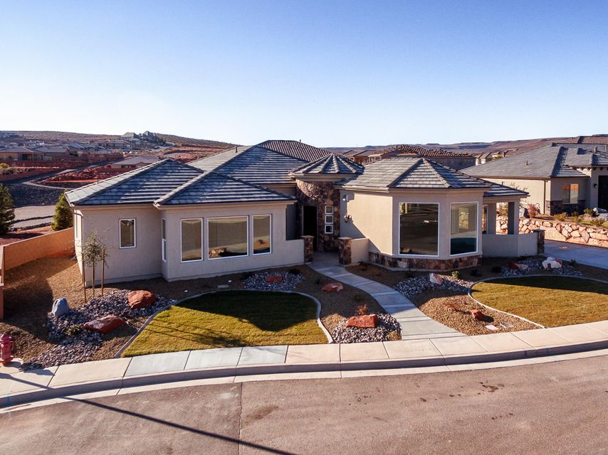 Single level living at its finest! Carefully placed patios and abundant, oversized windows, make you feel as one with the mountainous beauty that surrounds you. From its 10\