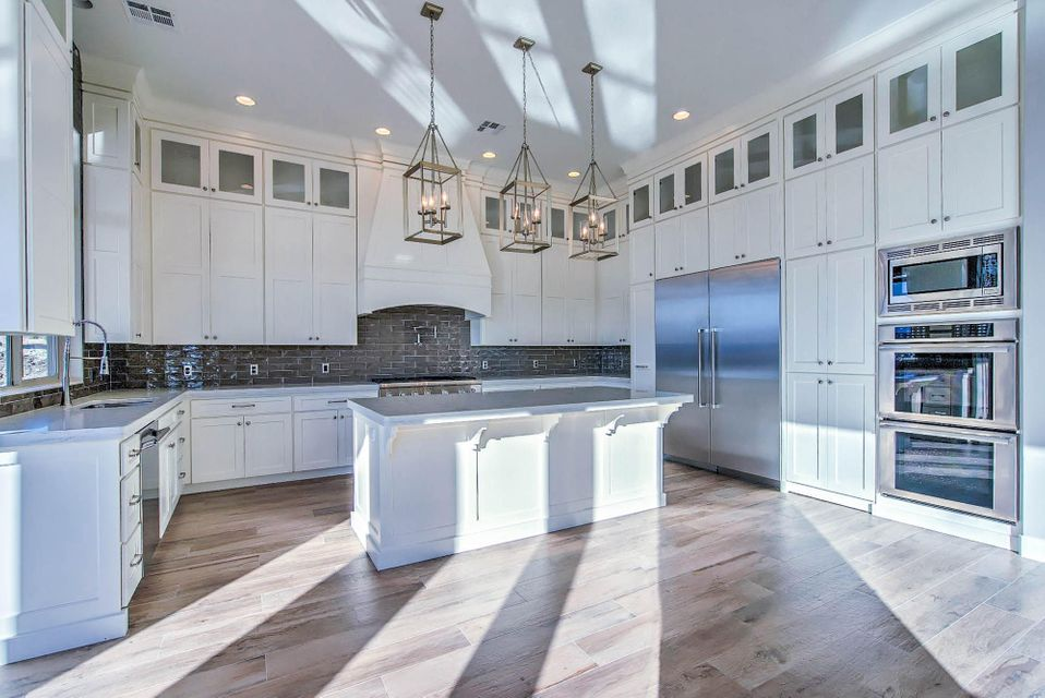 Outstanding NEW home professionally designed - Custom cabinetry, upgraded designer lighting in every room, customized wainscoting, built in window seat, upgraded back splash and mirrors in all five bathrooms, quartz counter tops throughout, custom pool bathroom, built in 12\