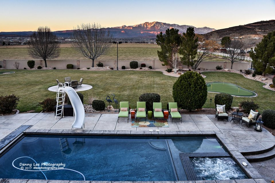 This stunning classic residence is located in a quaint and quiet neighborhood that backs agricultural land looking out at Pine Mountain. Impeccable features include custom architectural millwork, granite, Travertine and hardwood flooring, Crestron whole home automation, and a gorgeous staircase with custom iron work. The main level offers a formal living and dining room, great room, detached ->