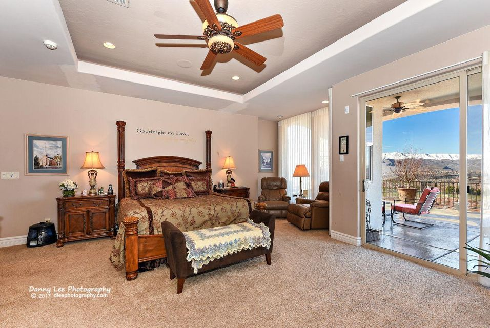 These combined two homes with 12,832 s.f., 2 x 6 walls, 6 car garages,an enclosed inside home pool, sauna, spa, covered patio with outside kitchen, built in barbeque, & unblockable panoramic views of red mountains, Utah hills, view of City, view of golf course, & much more can\