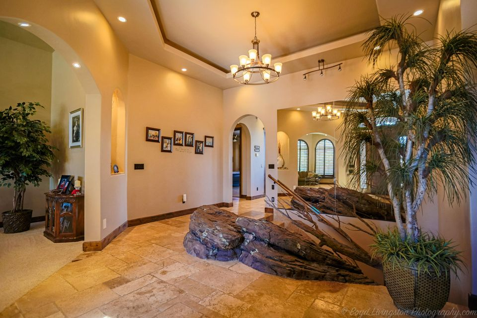 See the attached Virtual Video of this beautiful estate with the feeling of warmth and home. This is the builder\