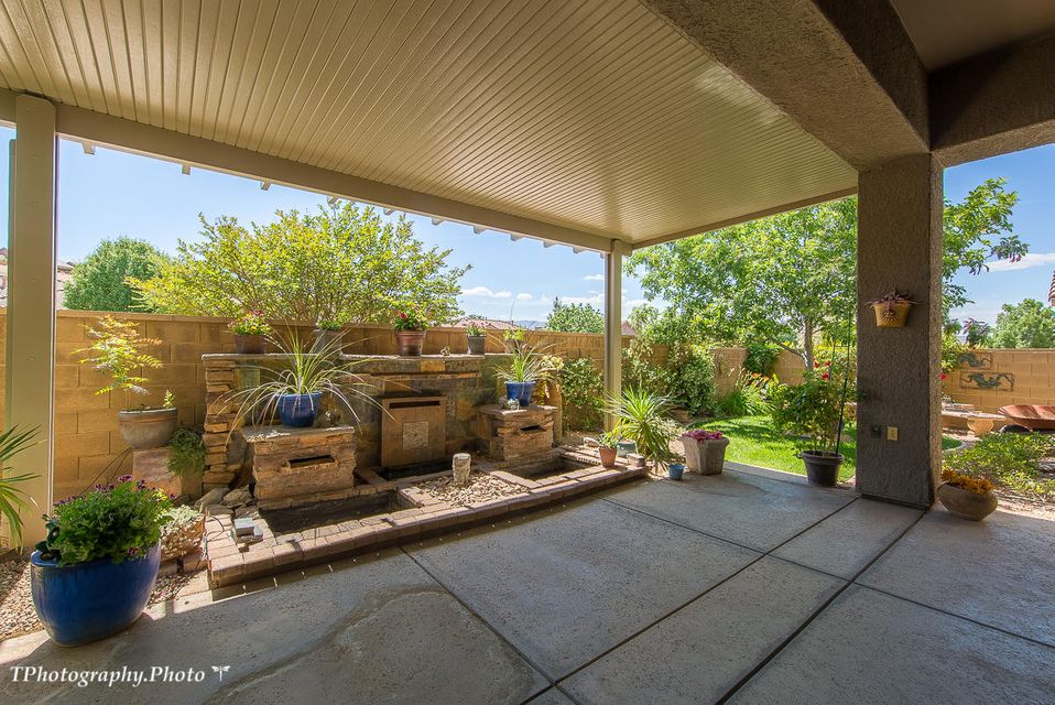 Upgrades galore! Tranquil backyard with fountain, 2 Master Suites, and den, office or what ever you need. Some owners use this room as a dining room, others a guess room. Inlaid tile entry, granite counter tops, extra height cabinets in kitchen, 18\