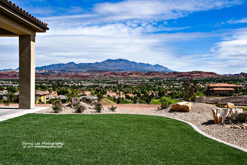 Beautiful Sunbrook lot with a breathtaking view of Snow Canyon, Red Mountain and Pine Valley Mountain. Low HOA covers complete landscape maintenance and state-of-the-art amenities.